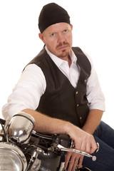 Man bandana sit on motorcycle side serious