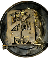 cobwebs and dust on the clock mechanism