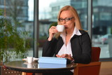 Atractive middle-aged blond businesswoman working