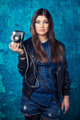 beautiful young woman holding camera