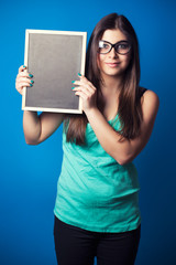 beautiful young woman holding blackboard