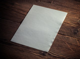 White paper on wood background