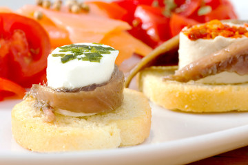 canapè with anchovy and cheese with spices