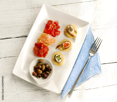 delicious appetizer with anchovy and salmon