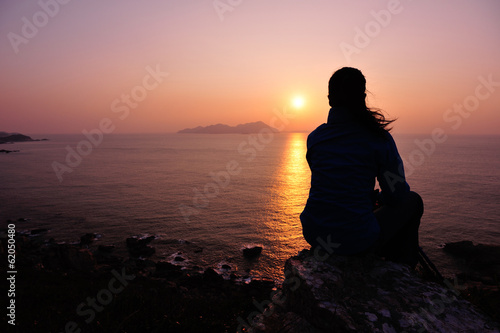 hiking woman enjoy the sunrise seaside