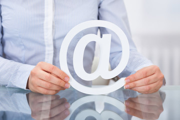 Businessperson Holding Email Sign At Workplace
