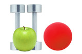 Chromed fitness dumbbells, red ball and green apple isolated on