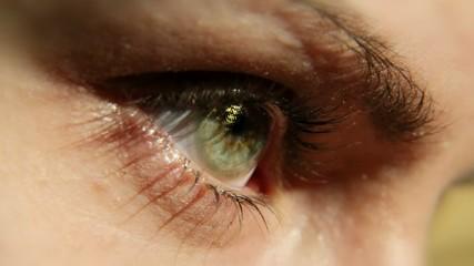 A girl eye wearing cosmetic contact lens (Gold).