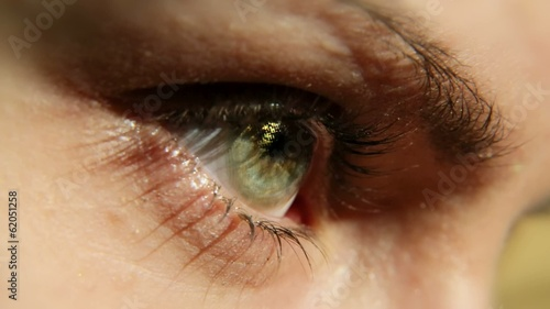 A girl eye wearing cosmetic contact lens (Gold).