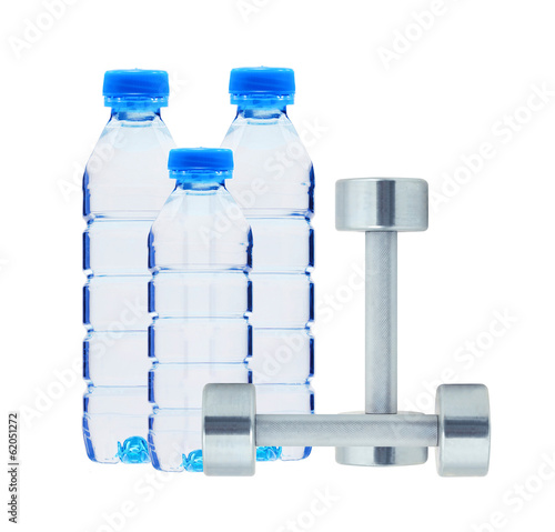 Blue bottles with water and dumbbells isolated on white