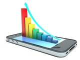 Business concept: touchscreen smartphone and bar chart