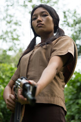 Asian woman armed