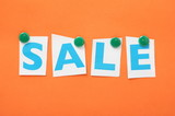 The word Sale in cut out paper letters