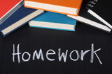 Homework and School Books on a Blackboard
