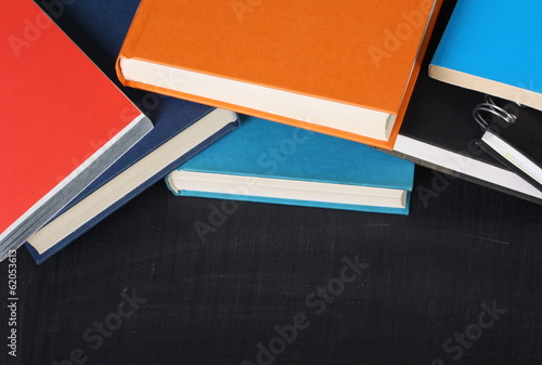 School Books on a blackboard with copy space