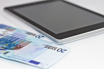 tablet-PC and EURO on white background