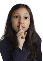 girl making silence gesture fingering