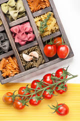 Assorted Italian pasta and spaghetti tomatoes in  wooden box