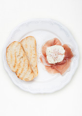Poached eggs with parma ham  prosciutto and ciabatta