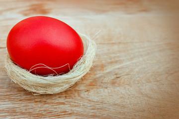 Red Easter egg in nest