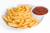Plate of French Fries over white background
