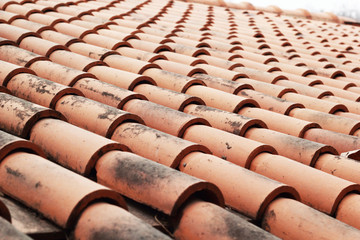 Close up of red roof tiles.