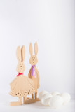Easter bunnies and white eggs on white background