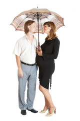 happy young pregnant woman with her husband under umbrella