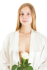 portrait of a beautiful naked girl with white rose