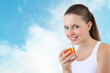 smiling woman drinking orange juice vitamin