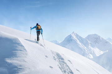 Touring skier in the alps