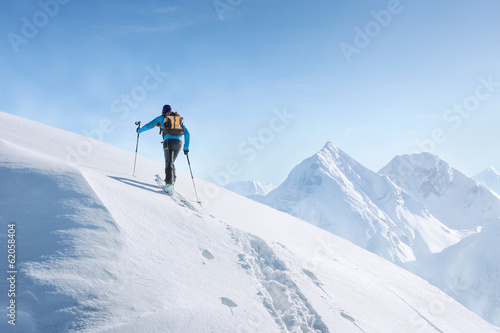 Foto op Canvas Wintersporten Touring skier in the alps