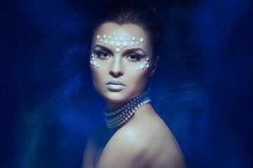 Girl with pearl facial design