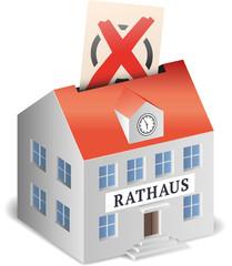 Rathaus als Wahlurne symbolisch mit Wahlzettel und Kreuz