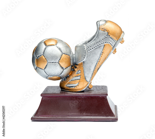 Prize in the form of shoes and a soccer ball on a stand