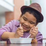 Cute boy enjoy eating food