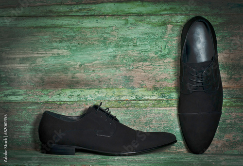 Man's shoes on wooden background