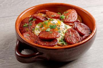Spanish tapas with potatoes, iberian ham, chorizo sausage,egg