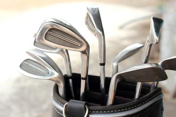 metal golf clubs in bag