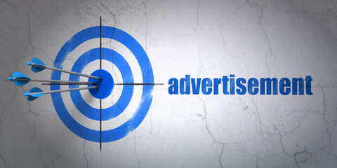 Marketing concept: target and Advertisement on wall background