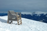Big wooden chair in Alps in winter