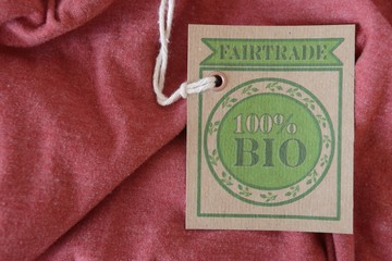 Red blouse with certified organic fabric label.