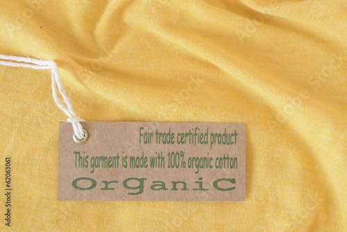 Yellow garment with certified organic fabric label.
