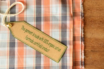 Plaid garment with certified organic fabric label.