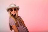 Blonde teenage girl hat and sunglasses