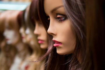 mannequins in a wig shop