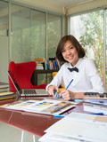 Portrait of Asian woman interior designer working