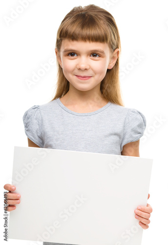 Little girl is holding blank banner
