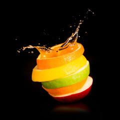 Apples, orange and citrus fruit. Splash juice.