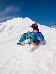 boy sledging